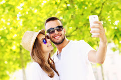 Young couple taking selfie in the park Royalty Free Stock Photos