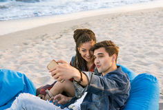 Young couple taking selfie photo at the beach Stock Image