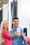 Young Couple Taking Selfie Photo Fitting Room Fashion Shop, Happy Smiling Man And Woman Shopping Customers Trying Stock Images