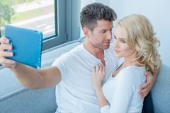 Young couple taking a selfie portrait picture Stock Image