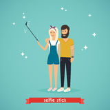 Young couple taking a selfie with selfie stick. Cartoon man and Stock Photography