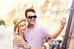 Young couple taking selfie while sightseeing the city Stock Photography