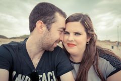 Young couple taking selfie with smartphone or camera at the beac. H Royalty Free Stock Images