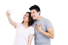 Young couple taking a selfie on smartphone Stock Photos