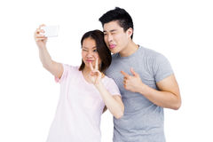 Young couple taking a selfie on smartphone Royalty Free Stock Photo