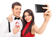 Young couple taking selfie with their engagement ring Stock Image