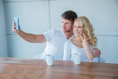 Young couple taking a selfie on their mobile Royalty Free Stock Photo