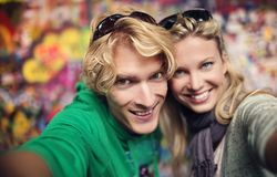 Young couple taking selfie of themselves Stock Photo