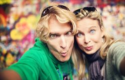 Young couple taking selfie of themselves Royalty Free Stock Photography