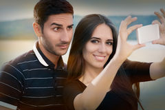 Young Couple Taking a Selfie Together Royalty Free Stock Images