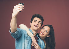 Young couple taking selfies Stock Photo