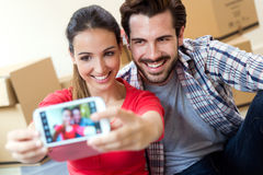 Young couple  taking selfies in their new home Stock Photo
