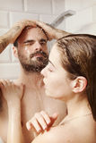 Young couple taking shower. Royalty Free Stock Images