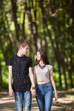 Young couple taking a walk in the park. Lifestyle and relationship. Young inlove boyfriend and girlfriend Stock Image