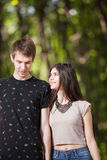 Young couple taking a walk in the park. Lifestyle and relationship. Young inlove boyfriend and girlfriend Royalty Free Stock Images