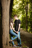 Young couple taking a walk in the park. Lifestyle and relationship. Young inlove boyfriend and girlfriend Royalty Free Stock Photo
