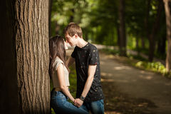 Young couple taking a walk in the park. Lifestyle and relationship. Young inlove boyfriend and girlfriend Stock Photos