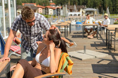 Talking young couple at beach bar Royalty Free Stock Photo