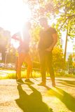 Young couple talking in the sunset in a urban environment. Young couple talking and chatting in the sunset in a urban environment stock image