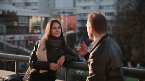 Young couple talking in city. Young couple Man and woman talking in city stock video footage