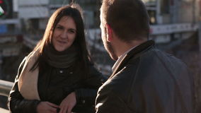 Young couple talking in city. Young couple Man and woman talking in city stock footage