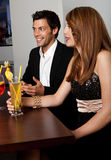 Young couple talking with friends Stock Photos