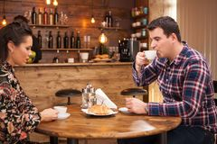 Young couple talking about the future in a cozy vintage pub. royalty free stock images