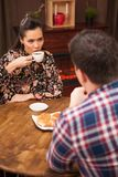 Young couple talking about the future in a cozy vintage pub. royalty free stock photo