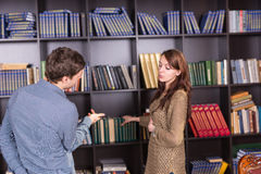 Young Couple Talking at the Mini Library Seriously Royalty Free Stock Photos