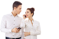 Young couple talking on mobile phone Royalty Free Stock Images