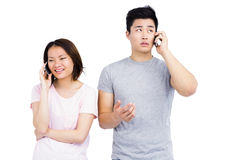 Young couple talking on mobile phone Royalty Free Stock Photos