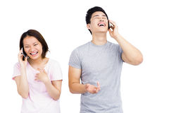 Young couple talking on mobile phone Royalty Free Stock Photography
