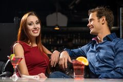 Young couple talking in a nightclub Stock Photo
