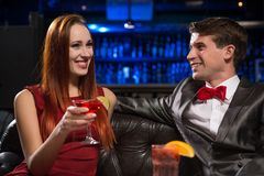 Young couple talking in a nightclub Royalty Free Stock Photo