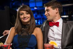 Young couple talking in a nightclub Royalty Free Stock Photos