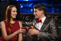 Young couple talking in a nightclub Royalty Free Stock Photography