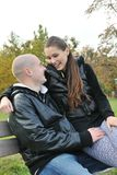 Young couple talking outdoors Royalty Free Stock Image