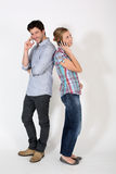 Young couple talking on the phone isolated Royalty Free Stock Photography