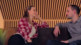 Young couple talking on the Sofa stock video footage