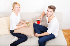 Young couple talking on the Sofa Stock Photos