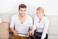 Young couple talking on the sofa Stock Image