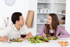 Young couple talking during their lunch Royalty Free Stock Photography