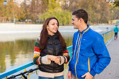 Young Couple Talking Together in Park in Autumn Royalty Free Stock Photos