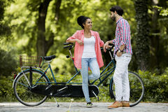Young couple by the the tandem bicycle Stock Photography