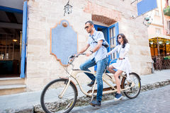 Young couple on tandem bicycle at the street city Royalty Free Stock Image