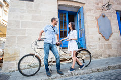Young couple on tandem bicycle at the street city Stock Image