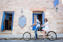 Young couple on tandem bicycle at the street city Royalty Free Stock Photos