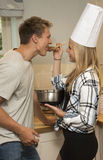 Young couple tasting food Stock Images