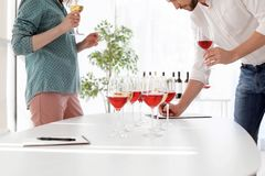 Young couple tasting wine at table indoors. Young couple tasting different wine at table indoors royalty free stock photos
