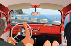 Young couple tavelling on coast road in retro car Royalty Free Stock Photos